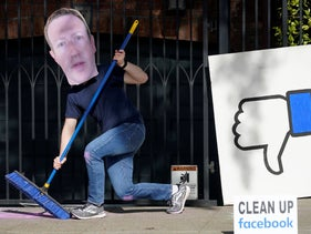 A man who did not give his name wears a mask of Facebook CEO Mark Zuckerberg as he and others demonstrate outside of Zuckerberg's home in San Francisco. November 21, 2020