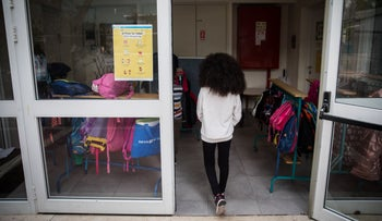 The child of asylum seekers walks into a school in south Tel Aviv, December 12, 2020.