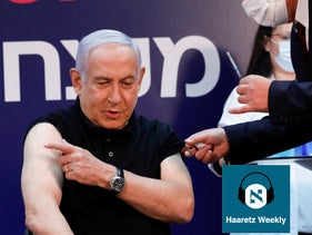 Prime Minister Benjamin Netanyahu receives a coronavirus vaccine at Sheba Medical Center, Ramat Gan, December 19, 2020.