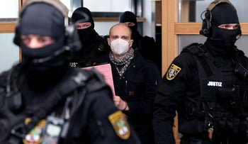 Stephan Balliet (C), who is accused of shooting dead two people after an attempt to storm a synagogue in Halle an der Saale, eastern Germany, arrives for his conviction on December 21, 2020 in Magdeburg, Germany