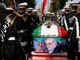 Members of Iranian forces carrying the coffin of Iranian nuclear scientist Mohsen Fakhrizadeh during his funeral in Tehran, November 30, 2020.