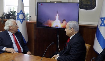 Prime Minister Benjamin Netanyahu, right, and U.S. Ambassador to Israel David Friedman watching a video showing the launch of the Arrow 3 hypersonic anti-ballistic missile during a cabinet meeting in Jerusalem, July 28, 2019.