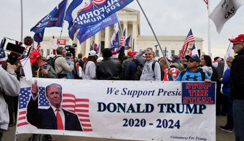 Supporters of U.S. President Donald Trump hold a banner as they rally to protest the results of the election in front of Supreme Court building, in Washington, December 12, 2020.