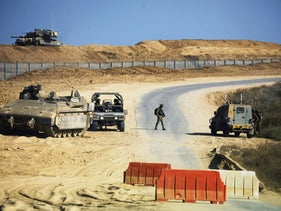 An Israeli soldier walks on a road along the border with the Gaza Strip, October 21, 2020.