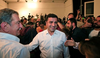 Selahattin Demirtas, co-chair of the pro-Kurdish Peoples' Democratic Party, (HDP) arrives for a news conference in Istanbul, Turkey, late Sunday, June 7, 2015