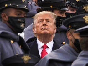 Surrounded by Army cadets, President Donald Trump watches the 121st Army-Navy Football Game in Michie Stadium, West Point Military Academy. Dec. 12, 2020