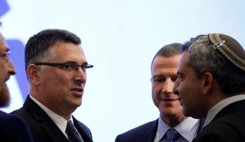 Sa'ar (center) and Elkin (far right) at a Likud campaign event in 2019.
