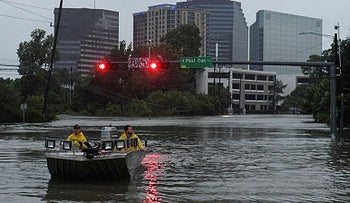 Rescue crews search for people in distress after Hurricane Harvey caused heavy flooding in Houston, Texas on August 27, 2017