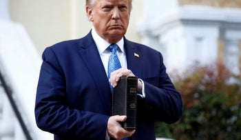 President Donald Trump holds a Bible outside St. John's Church across from the White House after peaceful protestors were forcibly cleared from the area. June 1, 2020