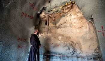 Fr. Francesco Patton, Custos of the Holy Land, next to the ancient ritual bath.