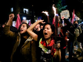 Anti-Netanyahu protesters carry torches as they march through Jerusalem, December 12, 2020.