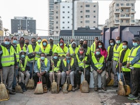 Asylum seekers working as street cleaners for the Tel Aviv municipality, December 24, 2020.