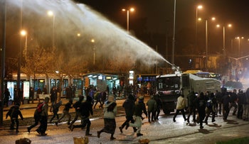 Protesters and police next to National Police Headquarters in Jerusalem, December 26, 2020.
