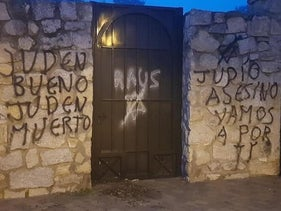 Graffiti calling for the murder of Jews at the entrance to the Jewish cemetery of Hoyo de Manzanares, Spain, December 24, 2020.