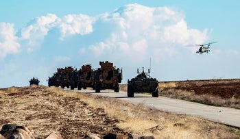 A joint Russian-Turkish patrol advances in the countryside of the Syrian town of al-Jawadiyah, in the northeastern Hasakeh province, near the border with Turkey, December 24, 2020.