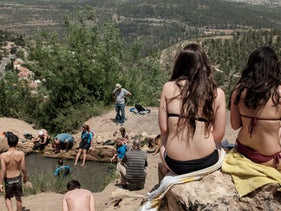Swimmers bathe at the Uzi spring near Jerusalem, 2017.