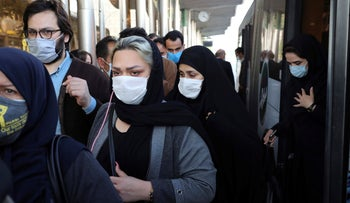 People wear protective face masks to help prevent the spread of the coronavirus in downtown Tehran, Iran, October 11, 2020