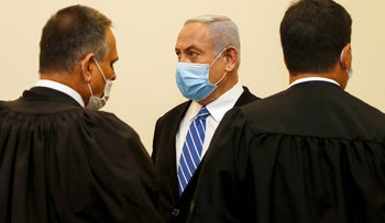 Prime Minister Benjamin Netanyahu and his lawyers at the Jerusalem District court as his corruption trial begins, May 2020.