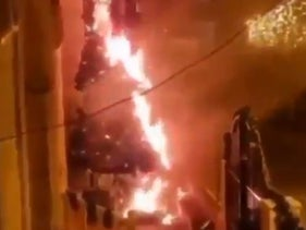 Screen capture of a video showing a Christmas tree engulfed in flames in the Israeli Arab city of Sakhnin, December 29, 2020
