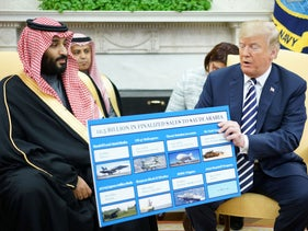 U.S. President Donald Trump holds a defense sales chart with Saudi Arabia's Crown Prince Mohammed bin Salman in the Oval Office of the White House, March 20, 2018.
