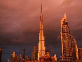 Sunlight reflects off the Burj Khalifa, the world's tallest building, during a rain shower in Dubai, United Arab Emirates