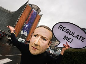 A campaigner wearing a mask of Facebook CEO Mark Zuckerberg, outside the European Commission in Brussels on the day the Digital Services Act is published, December 15, 2020.