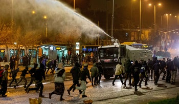 Police use water cannons against protesters against the death of Ahuvia Sandak in front of National Police Headquarters in Jerusalem, December 27, 2020.