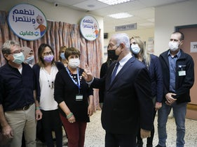 Benjamin Netanyahu speaks during a visit to a vaccination center in Tira, December 31, 2020.