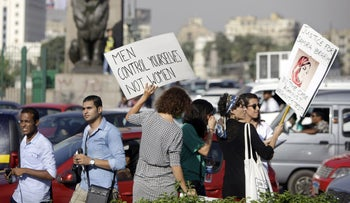 Women protest against sexual abuse in Cairo, 2014.