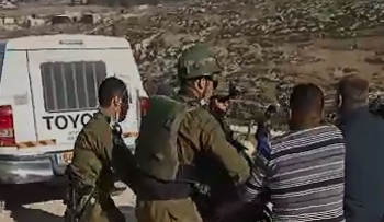 A screenshot from the video showing soldiers clashing with Palestinians near Hebron, January 1, 2021.