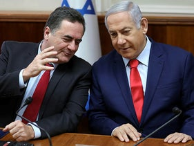 Israeli Prime Minister Benjamin Netanyahu, right, with current Finance Minister Yisrael Katz, during the weekly cabinet meeting at his Jerusalem office, Sunday, May 12, 2019.