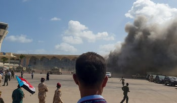 Smoke billows after explosions rocked the Aden Airport shortly after the arrival of a plane carrying members of a new unity government, Aden, Yemen, December 30, 2020.