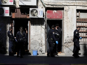 Police officers during an operation to close brothels in Tel Aviv, March 2020.