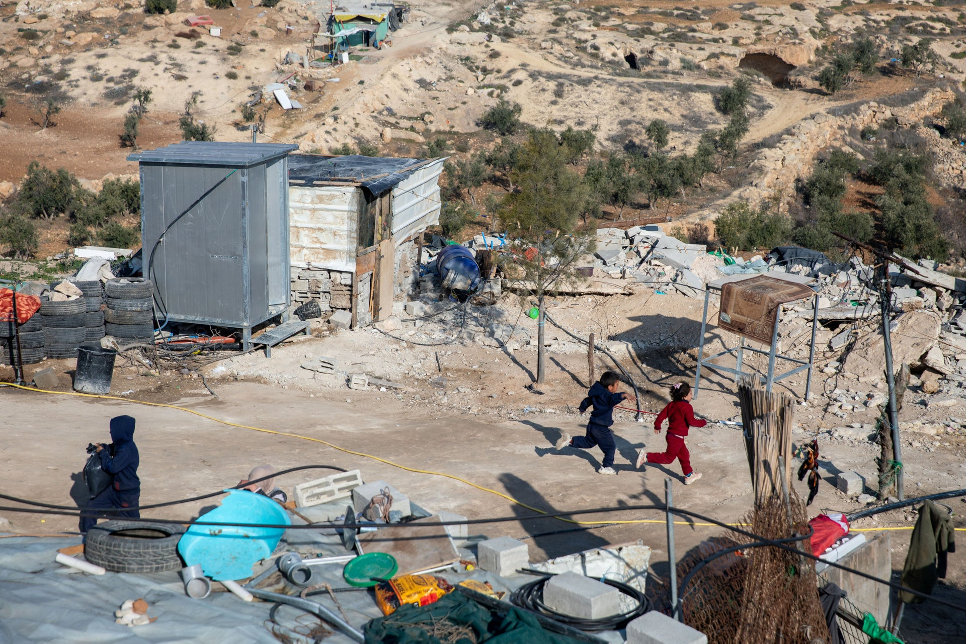 Children walk in the village of Khirbet al-Rakiz.