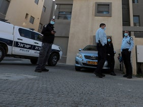 Police outside the home of a woman who was murdered in Yeruham on January 4, 2021.