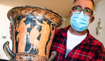 """Rare """"red and black"""" pottery vase restored, apparently by the thieves."""