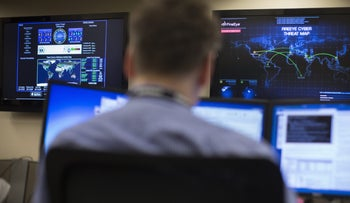 FILE PHOTO: A worker at a cyberdefense center