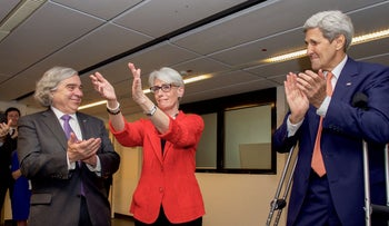 Wendy Sherman, U.S. Energy Secretary Dr. Ernest Moniz and U.S. Secretary of State John Kerry applaud after the Iran nuclear deal was reached, Vienna, Austria, July 14, 2015.