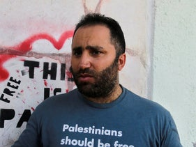 Palestinian activist Issa Amro speaks after his release from detention, in the West Bank city of Hebron, Sept. 10, 2017.