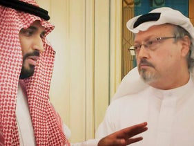 "Saudi Crown Prince Mohammed bin Salman with journalist Jamal Khashoggi, whose murder he instigated, in a scene from the documentary ""The Dissident"""
