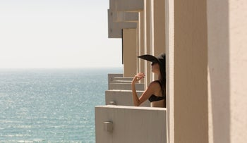 A female guest catching some sun during a quarantine stay at the Dan Panorama turned coronavirus hotel, September 10, 2020. For illustration purposes only.
