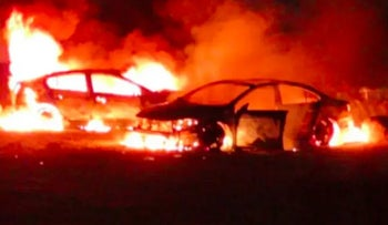 Palestinian vehicles allegedly set on fire by radical Israeli settlers near the Dead Sea, April 14, 2020.