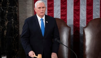 Vice President Mike Pence officiates as a joint session of the House and Senate convenes to confirm the Electoral College votes cast in November's election, at the Capitol in Washington, January 6, 2021.