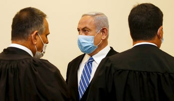 Israeli Prime Minister Benjamin Netanyahu and his lawyers during the first day of his corruption trial at the district court of Jerusalem, May 24, 2020.