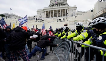 Trump supporters try to break through a police barrier at the Capitol in Washington, January 6, 2021.
