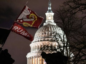 A Trump flag flies over the grounds of the U.S. Capitol after a pro-Trump mob stormed the Capitol. Washington, DC. January 6, 2021