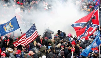 Tear gas is released into a crowd of protesters during clashes with Capitol police, Washington D.C., January 6, 2021.
