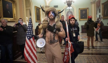 Supporters of President Donald Trump are confronted by U.S. Capitol Police officers outside the Senate Chamber, January 6, 2021, in Washington.