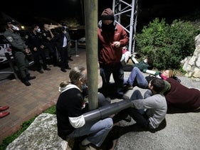 Protesters use a device built by Oded Alish during a protest outside Defense Minister Benny Gantz in Rosh HaAyin, central Israel, December 20, 2020.