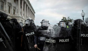 Members of law enforcement stand guard as pro-Trump protesters rally by the U.S. Congress, at the U.S. Capitol Building in Washington, D.C., U.S. January 6, 2021.